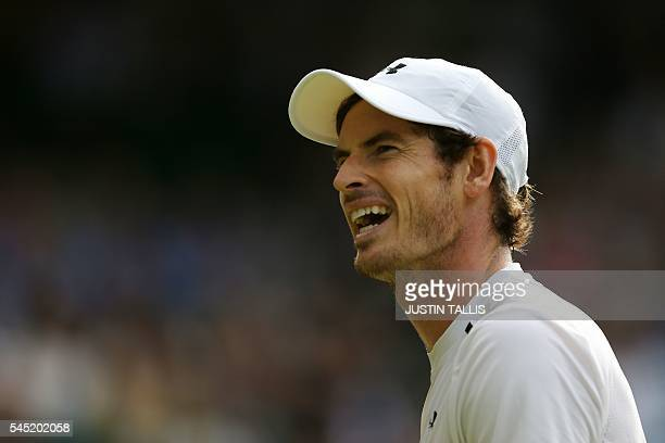 Britain's Andy Murray reacts after a point during his men's singles quarterfinal match against France's JoWilfried Tsonga on the tenth day of the...