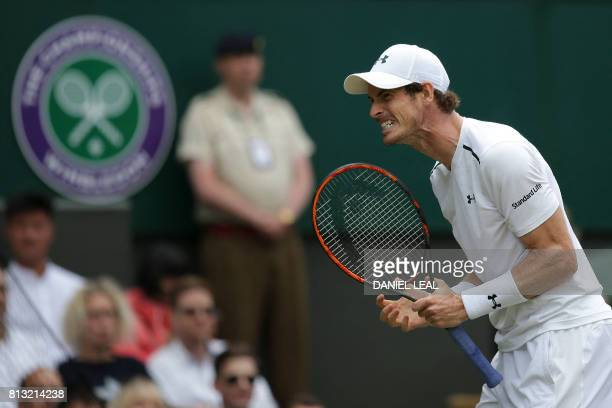 Britain's Andy Murray reacts after losing a point against US player Sam Querrey during their men's singles quarterfinal match on the ninth day of the...