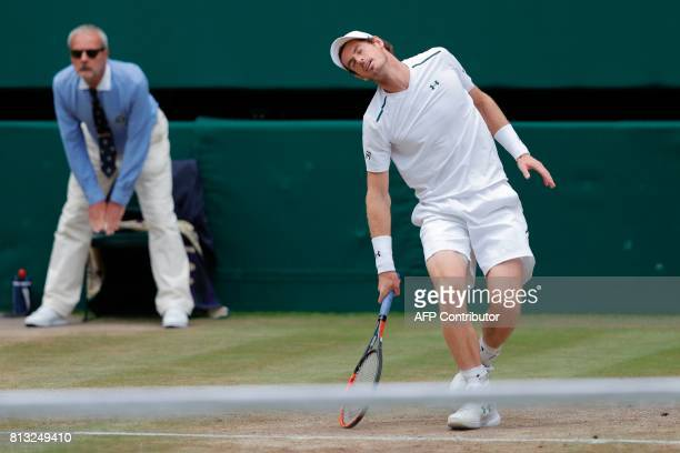 Britain's Andy Murray reacts after losing a service point against US player Sam Querrey during their men's singles quarterfinal match on the ninth...
