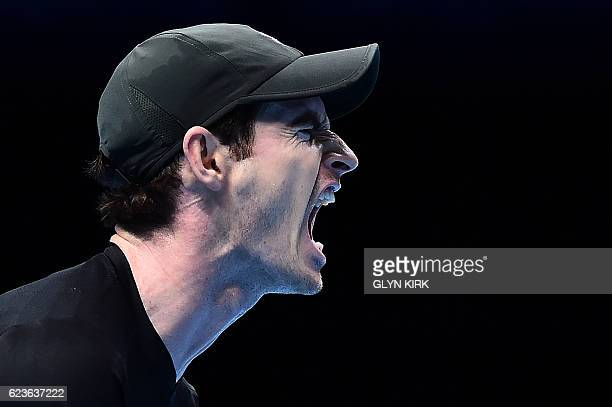 TOPSHOT Britain's Andy Murray reacts after losing the first set against Japan's Kei Nishikori during their round robin stage men's singles match on...