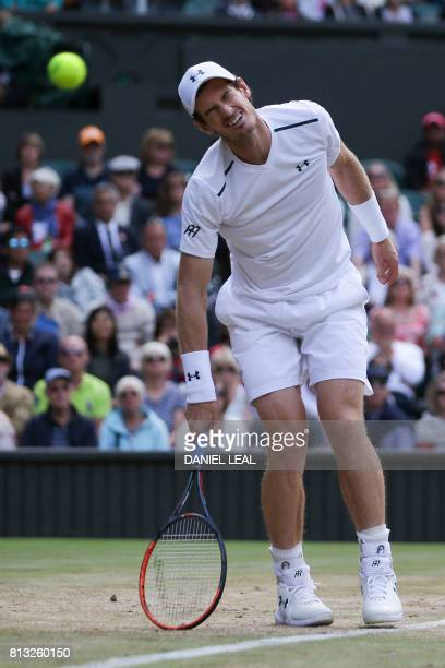 Britain's Andy Murray reacts after missing a shot against US player Sam Querrey during their men's singles quarterfinal match on the ninth day of the...