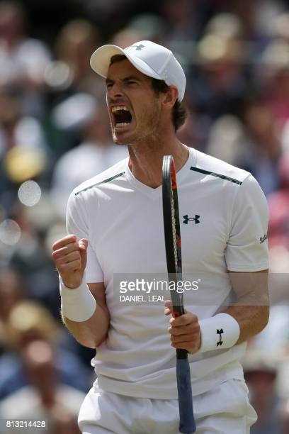 Britain's Andy Murray reacts after winning a game against US player Sam Querrey during their men's singles quarterfinal match on the ninth day of the...