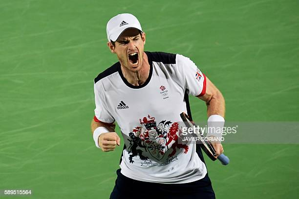 TOPSHOT Britain's Andy Murray reacts after winning a point against Argentina's Juan Martin Del Potro during their men's singles gold medal tennis...