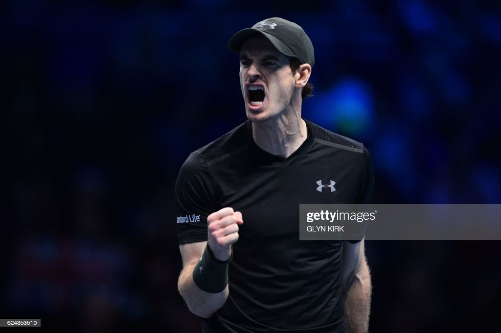 TOPSHOT - Britain's Andy Murray reacts after winning a point against Canada's Milos Raonic in the second set during their men's semi-final singles match on day seven of the ATP World Tour Finals tennis tournament in London on November 19, 2016. / AFP PHOTO / Glyn KIRK