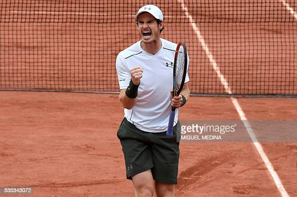 Britain's Andy Murray reacts after winning a point against US player John Isner during their men's fourth round match at the Roland Garros 2016...