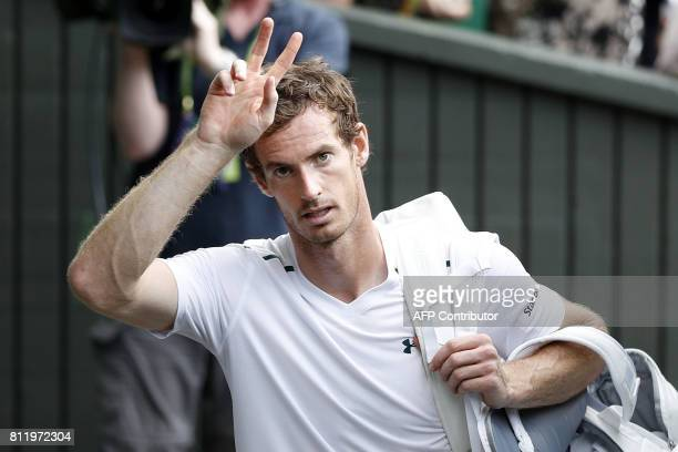 Britain's Andy Murray reacts after winning against France's Benoit Paire during their men's singles fourth round match on the seventh day of the 2017...