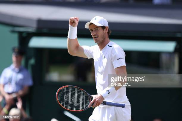Britain's Andy Murray reacts after winning the third set against US player Sam Querrey during their men's singles quarterfinal match on the ninth day...