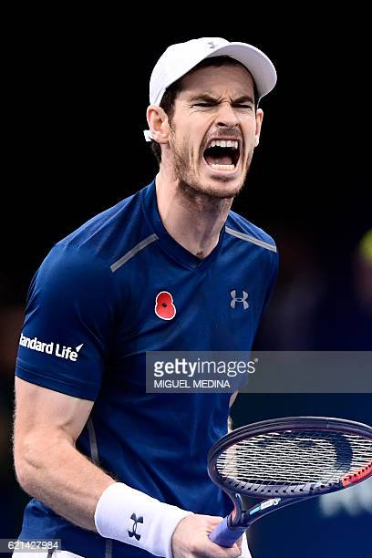 Britain's Andy Murray reacts during his final tennis match against USA's John Isner at the ATP World Tour Masters 1000 indoor tournament in Paris on...