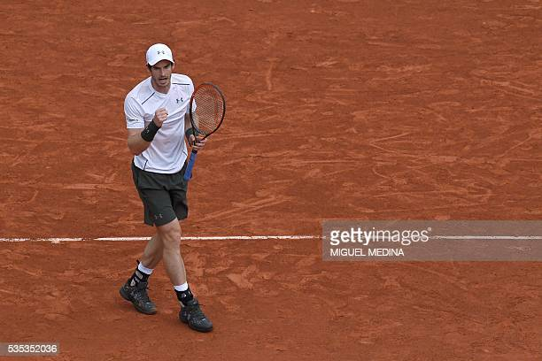 Britain's Andy Murray reacts during his men's fourth round match against US player John Isner at the Roland Garros 2016 French Tennis Open in Paris...