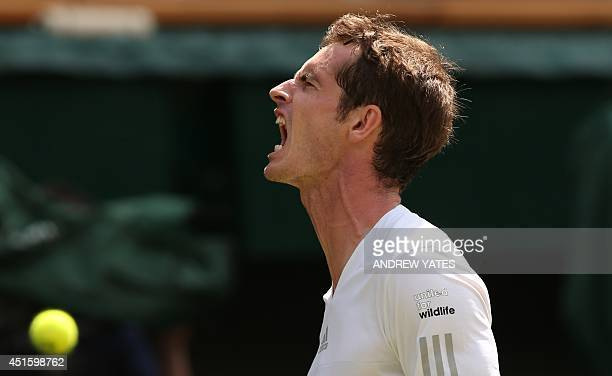 Britain's Andy Murray reacts to breaking the serve of Bulgaria's Grigor Dimitrov during their men's singles quarterfinal match on day nine of the...