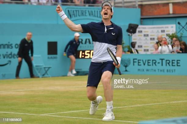 Britain's Andy Murray reacts to their win at match-point as he plays with Spain's Feliciano Lopez against US player Rajeev Ram and Britain's Joe...