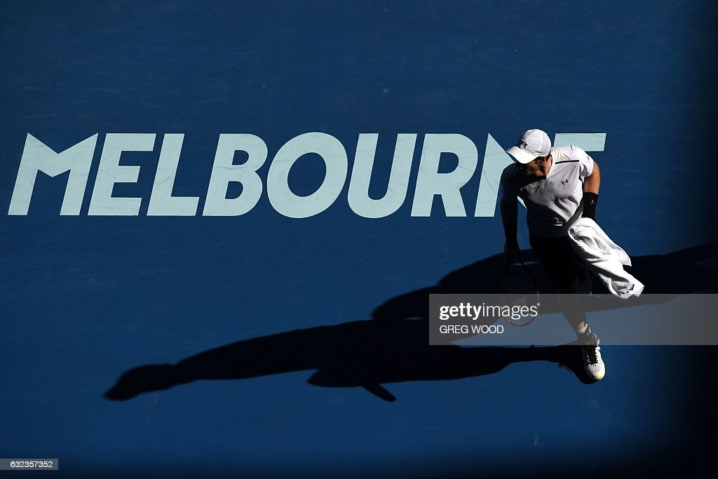 TOPSHOT - Britain's Andy Murray reacts while playing against Germany's Mischa Zverev during their men's singles fourth round match on day seven of the Australian Open tennis tournament in Melbourne on January 22, 2017. / AFP / GREG