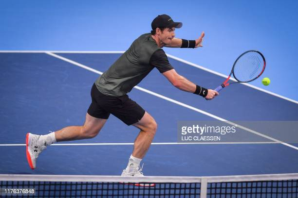 Britain's Andy Murray returns a shot during a tennis match against Uruguay's Pablo Cuevas in the second round of the men's singles tournament at the...
