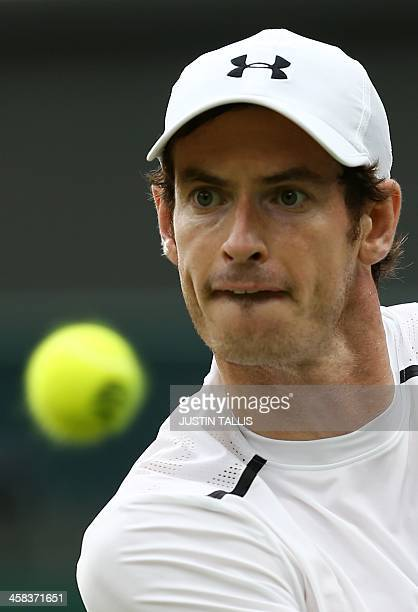 Britain's Andy Murray returns against Australia's John Millman during their men's singles third round match on the sixth day of the 2016 Wimbledon...