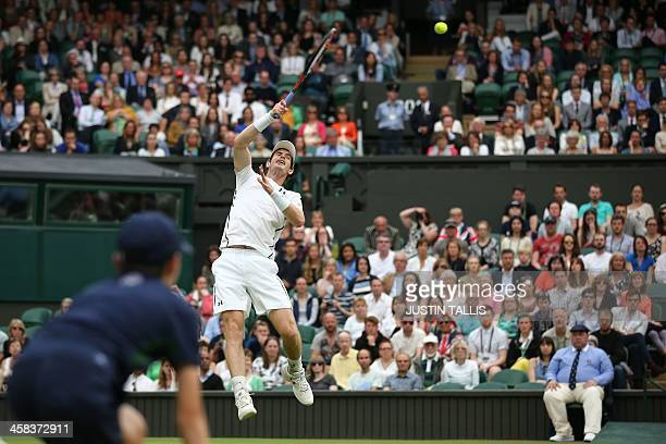 Britain's Andy Murray returns against Australia's John Millman in their men's singles third round match on the sixth day of the 2016 Wimbledon...