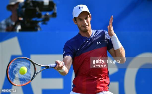 TOPSHOT Britain's Andy Murray returns against Australia's Jordan Thompson during their men's singles first round tennis match at the ATP Aegon...