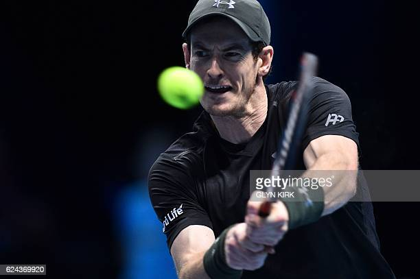 Britain's Andy Murray returns against Canada's Milos Raonic during their men's semi-final singles match on day seven of the ATP World Tour Finals...