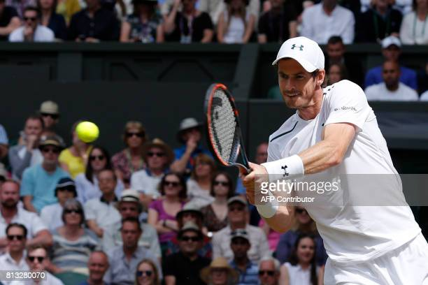Britain's Andy Murray returns against US player Sam Querrey during their men's singles quarterfinal match on the ninth day of the 2017 Wimbledon...