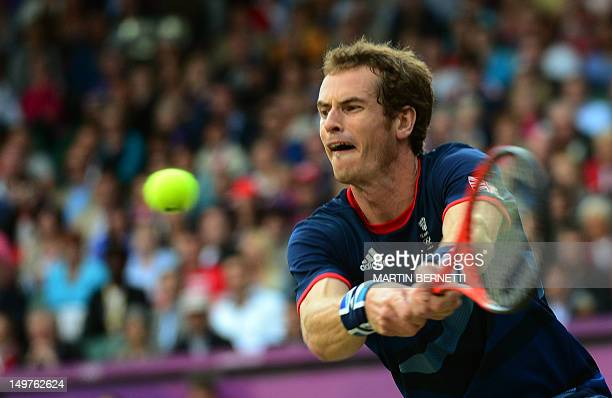 Britain's Andy Murray returns the ball during his men's singles semi-final tennis match against Serbian's Novak Djokovic at The All England Tennis...