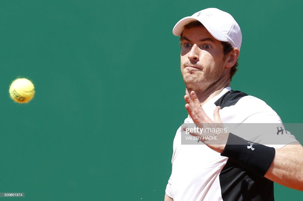 Britain's Andy Murray returns the ball to France's Pierre Hugues Herbert during the Monte-Carlo ATP Masters Series Tournament, on April 12, 2016 in Monaco.