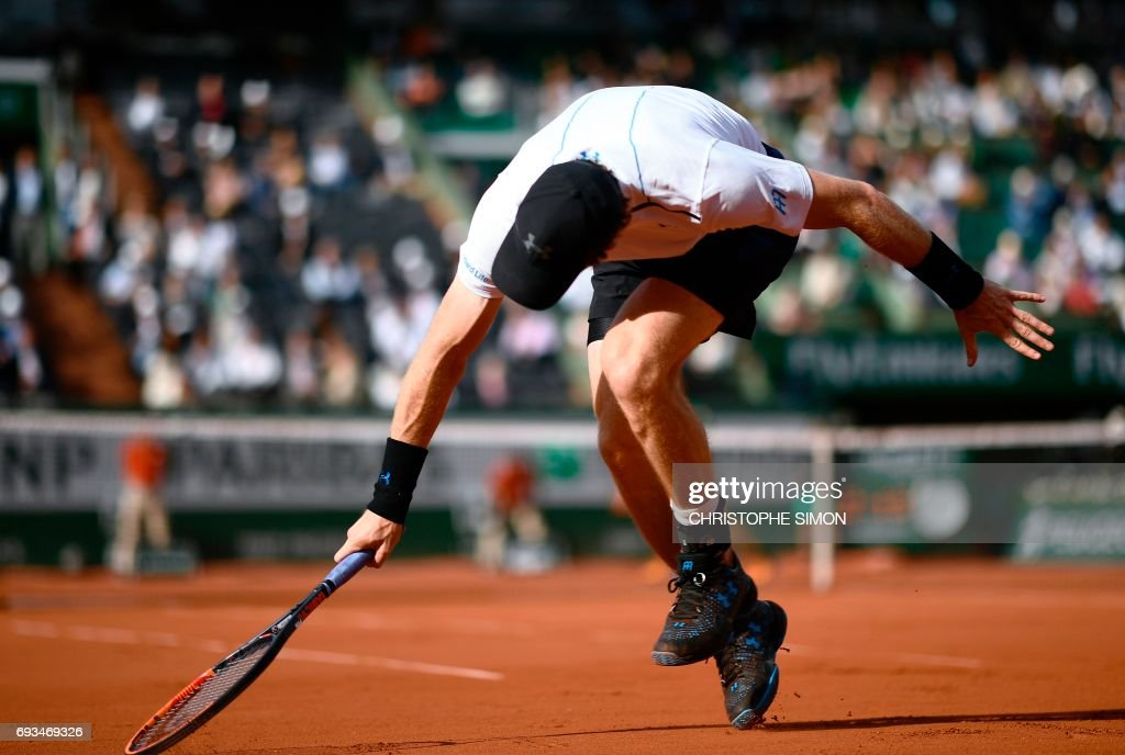 Britain's Andy Murray returns the ball to Japan's Kei Nishikori during their tennis match at the Roland Garros 2017 French Open on June 7, 2017 in Paris. /