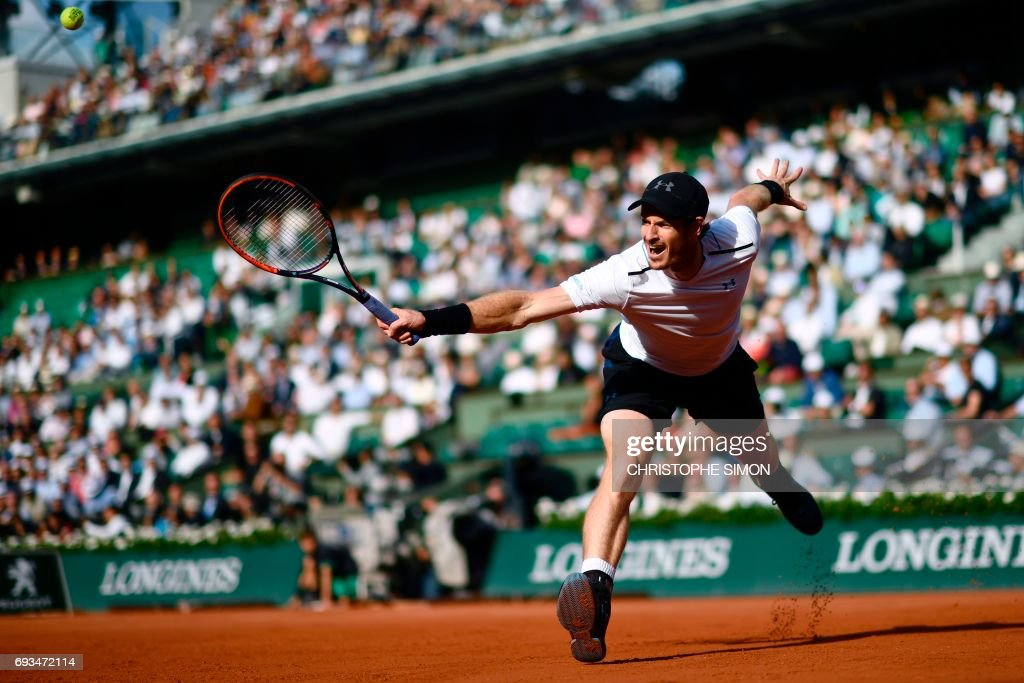 TOPSHOT - Britain's Andy Murray returns the ball to Japan's Kei Nishikori during their tennis match at the Roland Garros 2017 French Open on June 7, 2017 in Paris. /