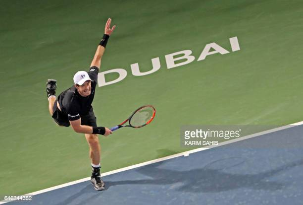 TOPSHOT Britain's Andy Murray returns the ball to Malek Jaziri of Tunisia during their ATP Dubai Duty Free Tennis Championship on February 28 2017 in...