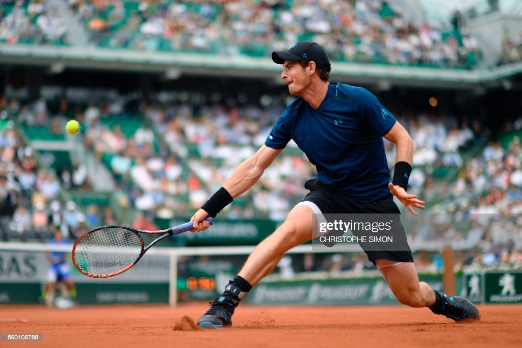 TOPSHOT - Britain's Andy Murray returns the ball to Russia's Andrey Kuznetsov during their tennis match at the Roland Garros 2017 French Open on May 30, 2017 in Paris. /