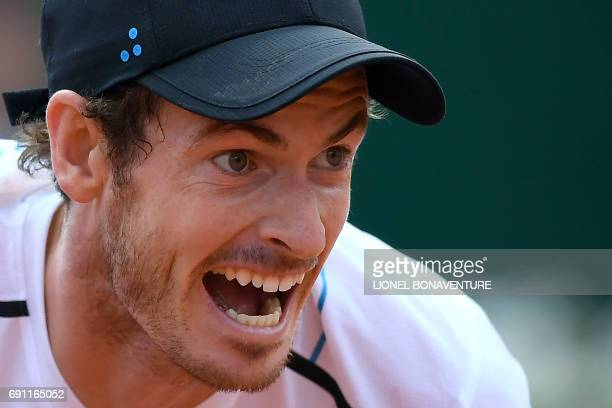 Britain's Andy Murray returns the ball to Slovakia's Martin Klizan during their tennis match at the Roland Garros 2017 French Open on June 1, 2017 in...