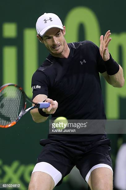 Britain's Andy Murray returns the ball to Spain's Nicolas Almagro during the quarterfinal of the ATP Qatar Open tennis competition in Doha on January...