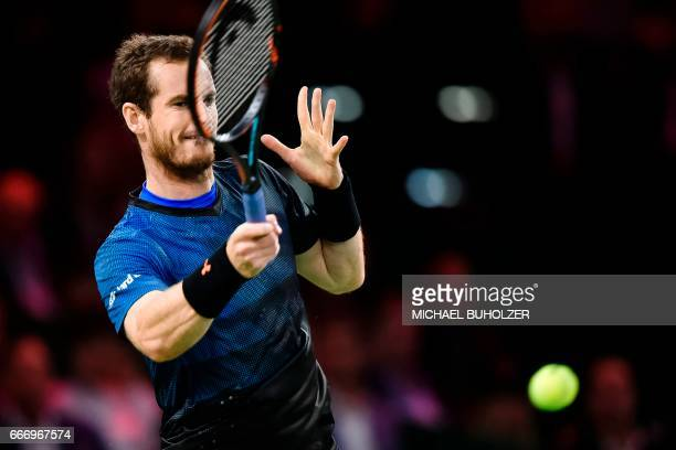 Britain's Andy Murray returns the ball to Swiss tennis superstar Roger Federer during a charity match The Match for Africa 3 on April 10 2017 in...