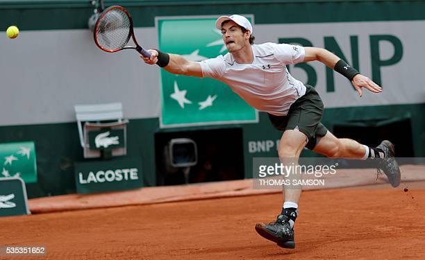 Britain's Andy Murray returns the ball to US player John Isner during their men's fourth round match at the Roland Garros 2016 French Tennis Open in...
