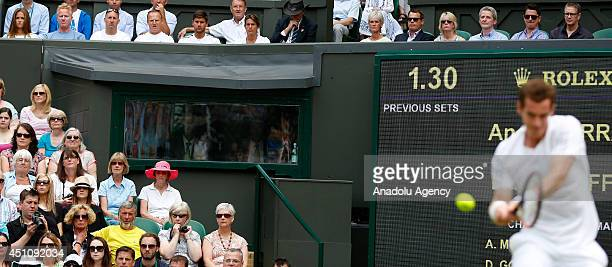 Britain's Andy Murray returns to Belgium's David Goffin during their men's singles first round match on day one of the 2014 Wimbledon Championships...