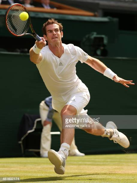 Britain's Andy Murray returns to Bulgaria's Grigor Dimitrov during their men's singles quarterfinal match on day nine of the 2014 Wimbledon...