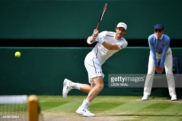 Britain's Andy Murray returns to Canada's Milos Raonic during the men's singles final match on the last day of the 2016 Wimbledon Championships at...