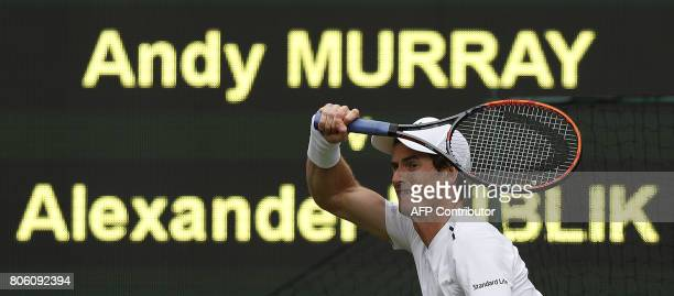 Britain's Andy Murray returns to Kazakhstan's Alexander Bublik during their men's singles first round match on the first day of the 2017 Wimbledon...