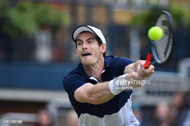 Britain's Andy Murray returns while playing with Spain's Feliciano Lopez against Britain's Dan Evans and Britain's Ken Skupski during their men's...