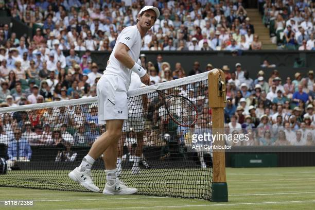 Britain's Andy Murray runs into the net after returning to France's Benoit Paire during their men's singles fourth round match on the seventh day of...