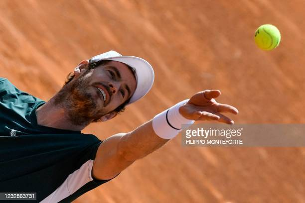 Britain's Andy Murray serves during his Men's double match with Britain's Liam Broady against Germany's Kevin Krawitz and Romania's Horia Tecau of...