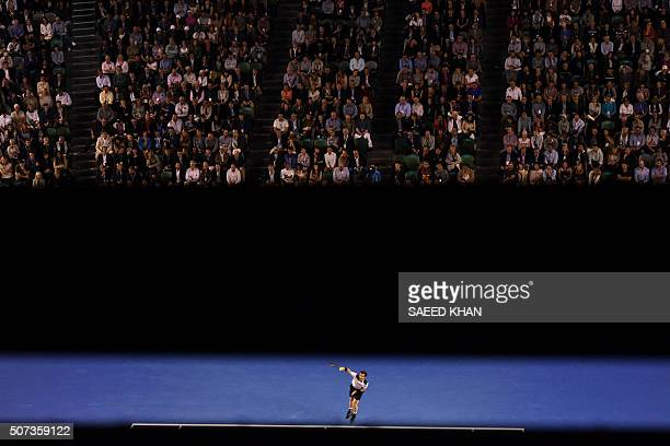 TOPSHOT Britain's Andy Murray serves during his men's singles semifinal match against Canada's Milos Raonic on day twelve of the 2016 Australian Open...