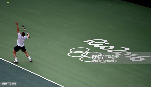 TOPSHOT Britain's Andy Murray serves the ball during a training session at the Olympic Tennis Center in Rio de Janeiro on August 2 ahead of the Rio...