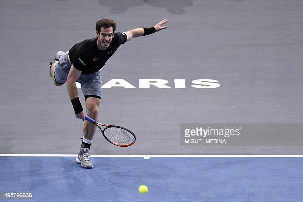 Britain's Andy Murray serves the ball to Belgium's David Goffin during their third round tennis match at the ATP World Tour Masters 1000 indoor...