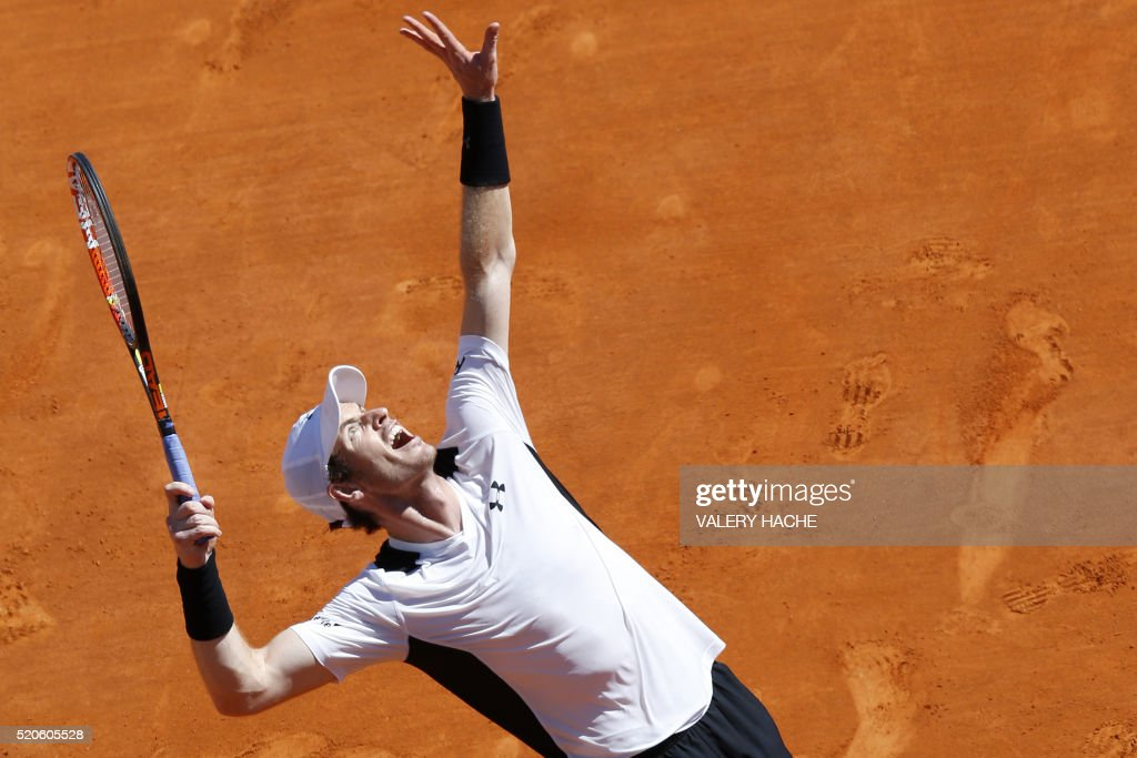 Britain's Andy Murray serves the ball to France's Pierre-Hugues Herbert during the Monte-Carlo ATP Masters Series Tournament, on April 12, 2016 in Monaco.