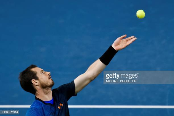 Britain's Andy Murray serves the ball to Swiss tennis superstar Roger Federer during a charity match The Match for Africa 3 on April 10 2017 in...