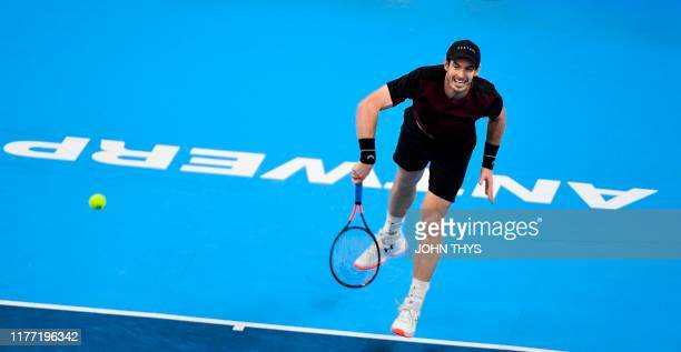 Britain's Andy Murray serves the ball to Switzerland's Stanislas Wawrinka during their men's single tennis final match of the European Open ATP...