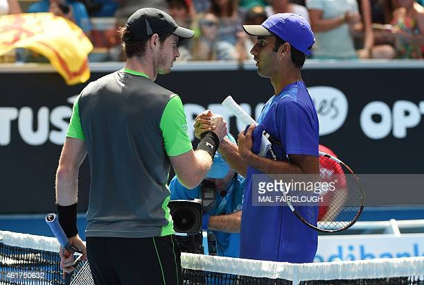 Britain's Andy Murray shakes hands with India's Yuki Bhambri after his victory in their men's singles match on day one of the 2015 Australian Open...