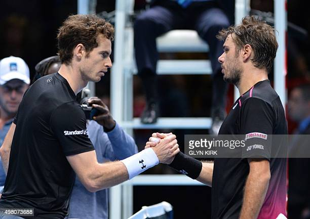 Britain's Andy Murray shakes hands with Switzerland's Stan Wawrinka after losing a men's singles group stage match on day six of the ATP World Tour...