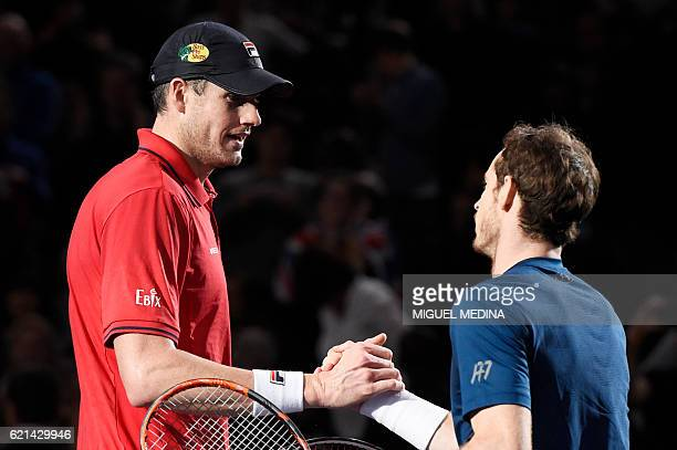 Britain's Andy Murray shakes hands with USA's John Isner after winning their final tennis match against at the ATP World Tour Masters 1000 indoor...