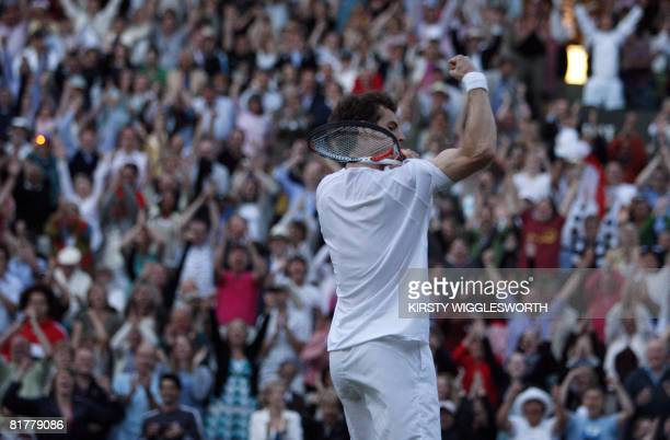 Britain's Andy Murray shows off his bicep as he celebrates beating Richard Gasquet of France in the fourth round during the 2008 Wimbledon...