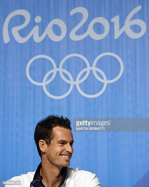 Britain's Andy Murray smiles as he attends a press conference at the Olympic Tennis Center in Rio de Janeiro on August 4 ahead of the Rio 2016...